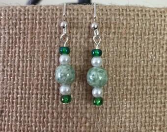 Green swirl, white pearl, & green glass bead earrings