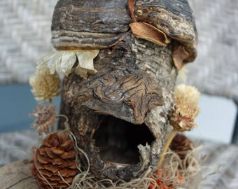 "Fairy house cottage made of birch bark and other natural materials found in the forest. Mounted on drift wood about 7"" tall."
