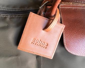 Leather luggage name * black