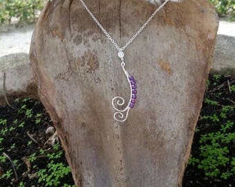 Eye catching handcrafted silver necklace.
