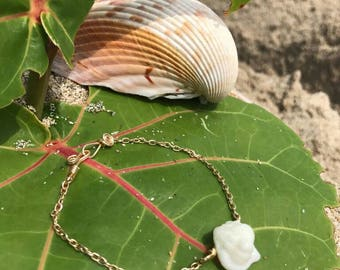 Cute handcrafted gold bracelet with a white murex seashell