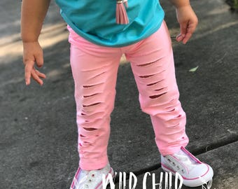 Distressed pink jeggings