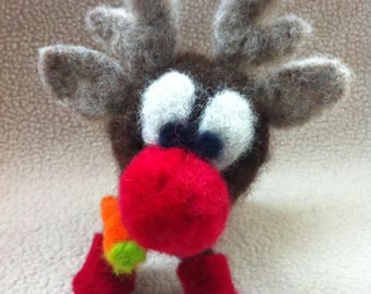 Red nose reindeer wearing red boots carrying his carrot. Needle felted, 7 by 7 inches. Christmas decoration, festive. Everyone will love him