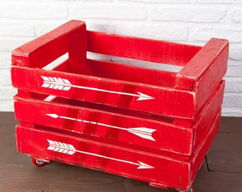 Fruit box restored and painted red with white arrows