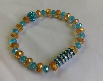Orange Glass Beads with Light Blue Accents & Blue Story Stick Stretch Bracelet