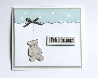 baby boy card. Blue, white, gray. Teddy bear and Ribbon