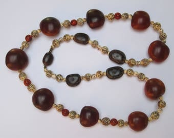 Multicolored necklace royal Palm seeds and donkey eye