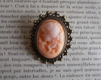 Metal with orange and white cameo brooch