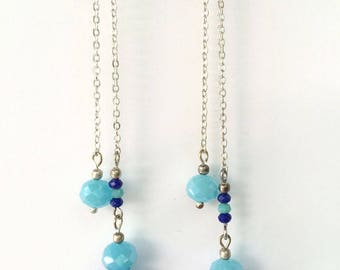 Lined with blue faceted glass beads earrings