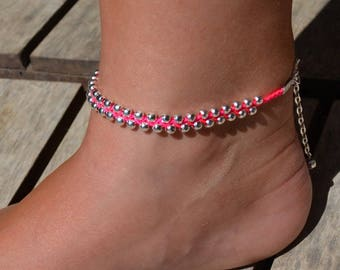 "Foot neon pink string ""beads"""