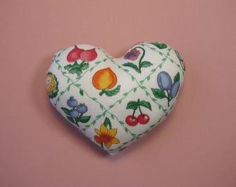 Pincushion, worn fabric heart pins, 10 cm x 8 cm.
