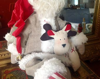 """Santa and his reindeer in matching fabric on red """"Tilda"""""""