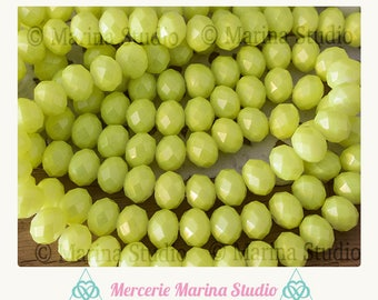 20 fluorescent 8x6mm faceted green glass beads