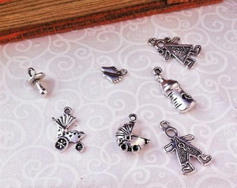 mixed lot 7 older children, silver baby themed charms