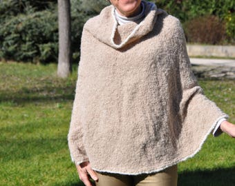 Needles, alpaca hand-knitted poncho