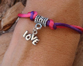 Pink and purple cord and silver bracelet. Love sign.