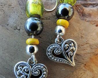 Heart Earrings in Tibetan silver, yellow glass bead. Sterling Silver bail.