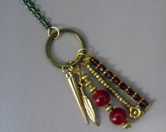 Long necklace, on a bronze chain with different charms.
