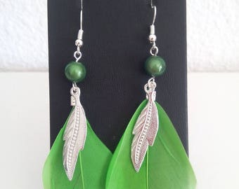 Green earrings with feathers