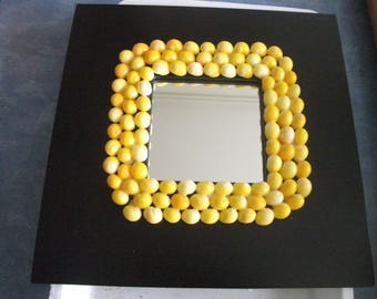 Mirror with black frame with yellow shells 25.5 cm x 25.5 cm (10 cm x 10 cm)