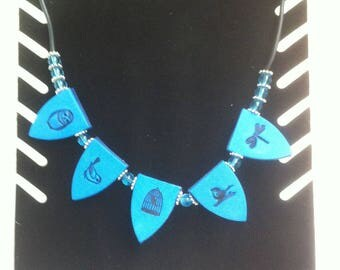 Turquoise necklace effect fabric and prints