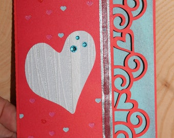 Red and pastel hearts card