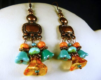 Earrings in copper and orange and turquoise beads