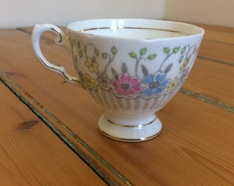 Vintage Tuscan floral bone china teacup in white, pink, yellow and blue
