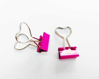 2 hot pink metal paper clips with heart shaped