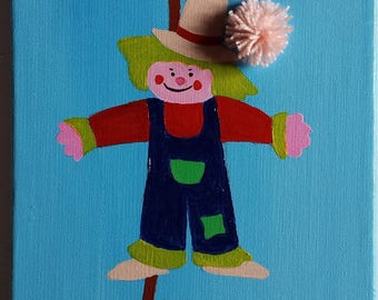 Scarecrow with a flower attached to his hat