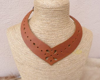 Crew neck tan perforated leather medieval style