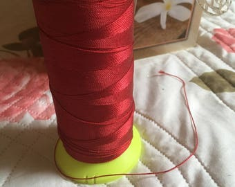 Red macrame cord or wire. 0.5 m.