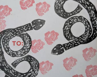 Linocut sticker of snakes and roses (1of1)