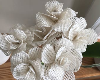 Hessian roses in white, weddings, buttonholes, table decorations and bouquets.