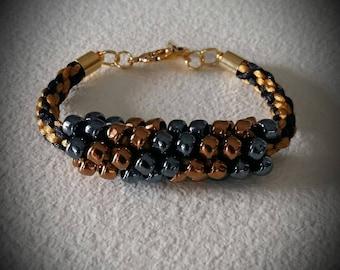 Shiny black and gold beaded bracelet