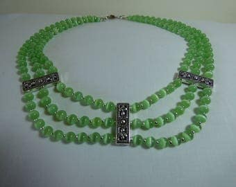 Necklace three rows of green cat's eye beads