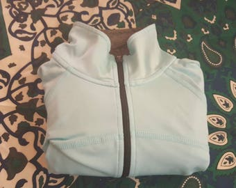Gently used DryTEK pullover in bright baby blue/teal & grey collar, 3/4 zip, long sleeve with thumb loops. Size M