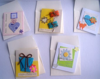 set of 5 small folded cards with envelope