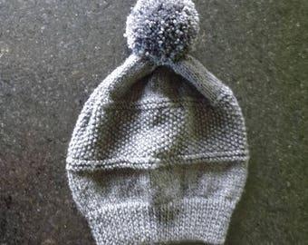 the pattern with a big Pompom handmade grey warm Cap dark knit