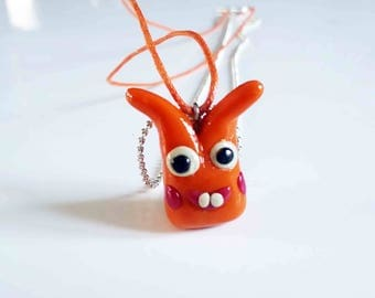 Orange Monster necklace with polymer clay