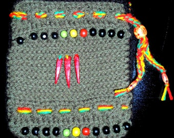 Purse made entirely by hand crocheted in rasta colors!