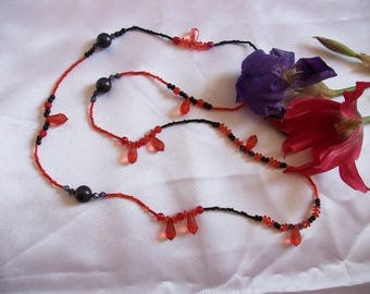 Necklace, red and black seed beads.