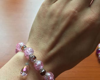 Pink bracelet and earrings with little sparkly purple pearls for women