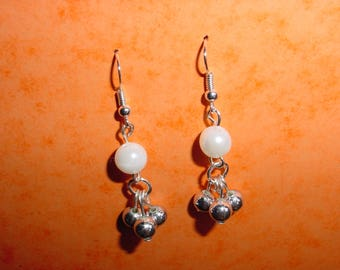 Silver tone and white earrings