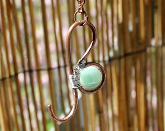 Zodiac sign of Leo in pink copper and gemstone