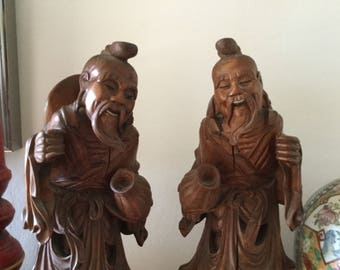 Two hand carved wooden figurines, Asian