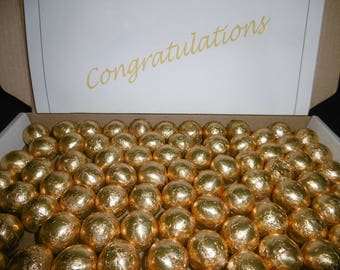 200 Gold balls with a designed congratulations label includes signed for postage