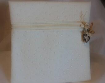 White faux leather diamond clutch