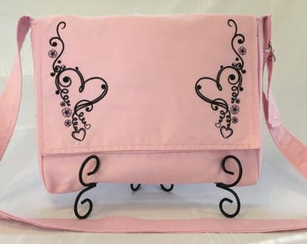 Messenger bag with embroidered heart scroll