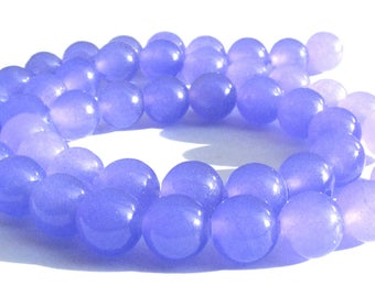 8 jades de 8 mm perles pierre mauve.